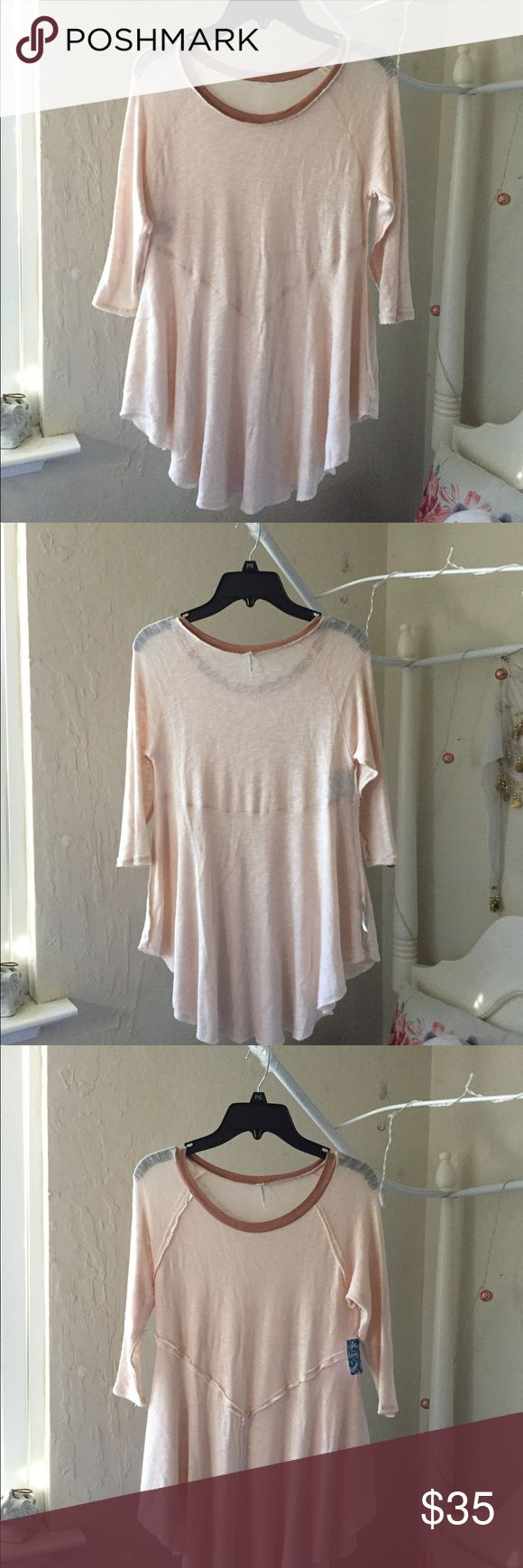 """• nwt free people soft & stretchy shirt • nwt free people distressed shirt. size xs but fits s fine. three quarter sleeves. very soft and very stretchy. retails $40. soft baby pink. color is called tea combo.   cute collar to add definition. style is weekends layering top. VERY FLATTERING! it looks great on everybody.   note: i showed the first two pics """"inside out"""", which i think is cuter. the right side is an open unfinished hem, but i didn't like it as much. it's definitely reversible if…"""