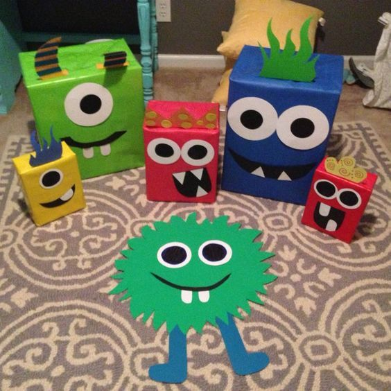 DIY Monster Party Decorations! Monster Birthday Decor So easy to make! I literally collected different sizes boxes from relatives/grocery stores/deliveries. I used solid wrapping paper, poster board, colored paper stock and hot glue! Get as funky, scary, silly as you want!