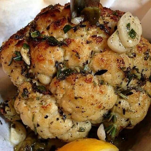 Roasted cauliflower with garlic, olives, lemon, thyme, rosemary