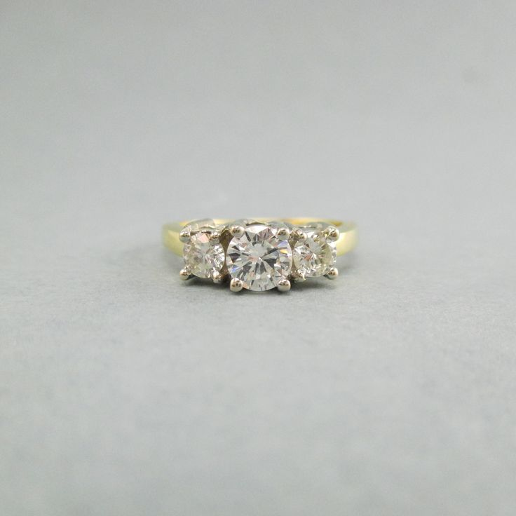 Vintage Estate 1.00ctw Diamond Engagement Band Past Present Future Prong Set 14kt Yellow & White Gold Bridal Wedding Ring # 674 / 1887  This beautiful vintage estate engagement ring features at its center three beautiful round cut diamond totaling 1.00ctw, SI2 in clarity and IJ in color. This band is arranged in a classic Past Present and Future design, making this ring a beautiful keepsake to pass down for generations!  Size: 6.75 Weight: 4.5 grams Metal Type: 14K Gold Feature Type:...