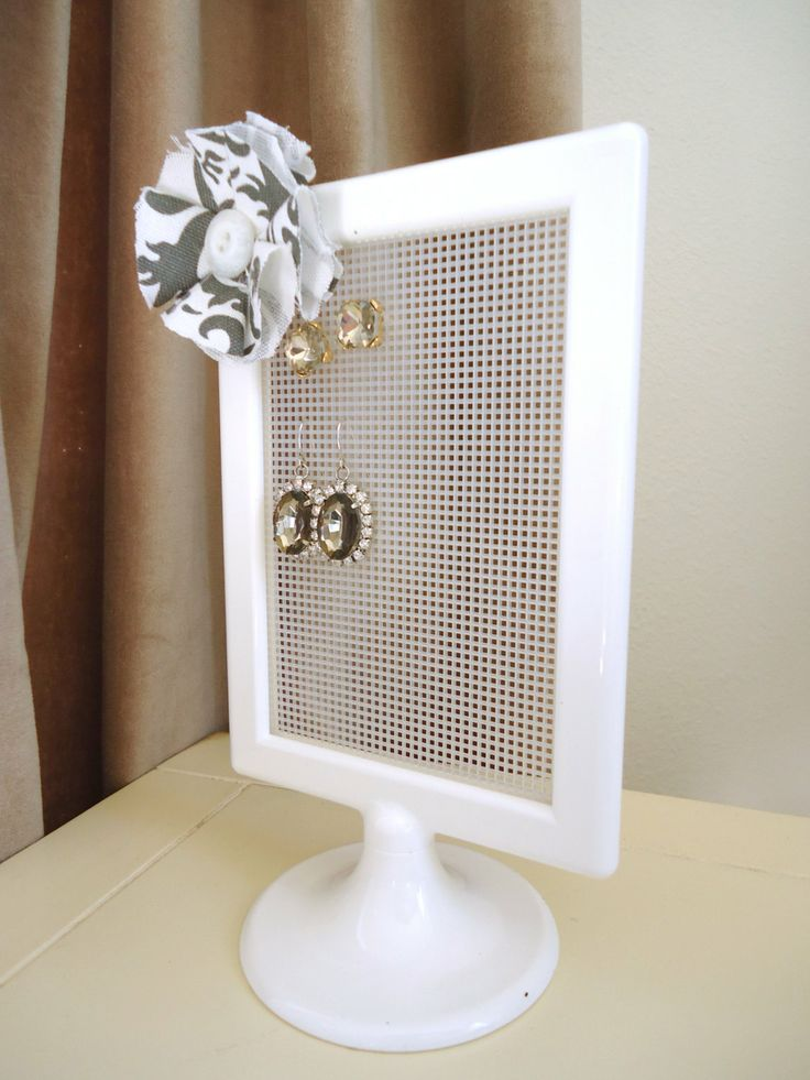 Earring Organizer  Make one...pix frame and plastic quilting sheet; hang w a ribbon; hang 2command hooks on wall, then put curtain rod up. Hang from this at a doable height