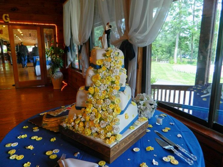 4 Tier offset Square Wedding Cake with yellow and white flowers.  Purple heart grooms cake.