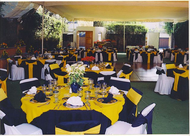 Green And Yellow Wedding Decorations With Round Tables And Wooden .