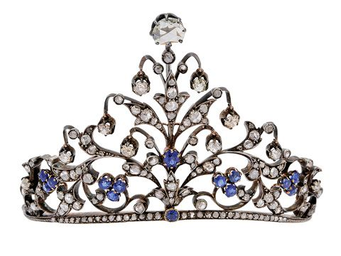 An Antique Sapphire and Diamond Tiara   The petite tiara of triangular peaked design extending from a narrow band, the floral and foliate motifs with rose-cut diamond leaves amid sapphire florets and buds, further embellished by suspended old mine-cut diamond drops, the apex enhanced by a larger rose-cut diamond, mounted in silver and 18k gold, French assay marks, with fitted box, late 19th century