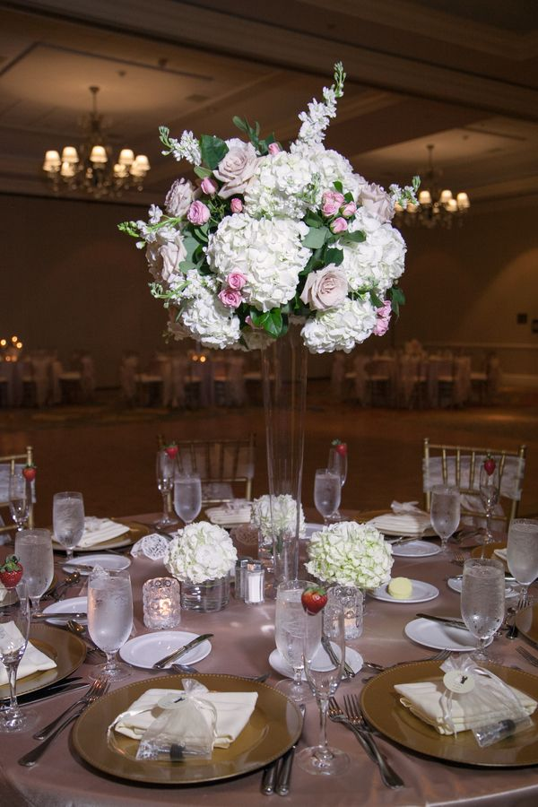 Romantic tall wedding centerpiece (Carrie Wildes Photography)