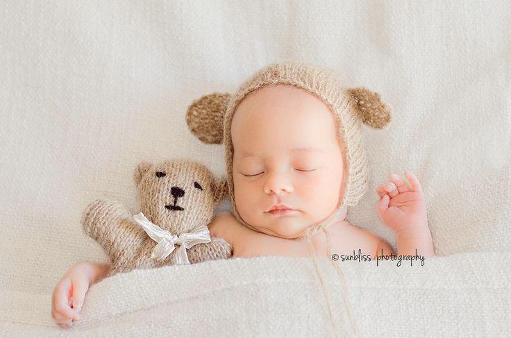 simple sweet newborn with a teddy bear