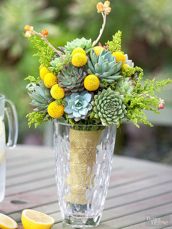 Bright yellow ball flowers add shape and pops of color to this green bouquet. We used Billy Ball flowers here to create the look./