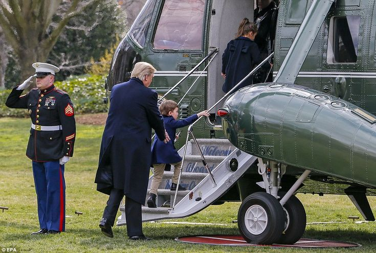 President Donald Trump then helped his grandchildren to board the presidential helicopter ...