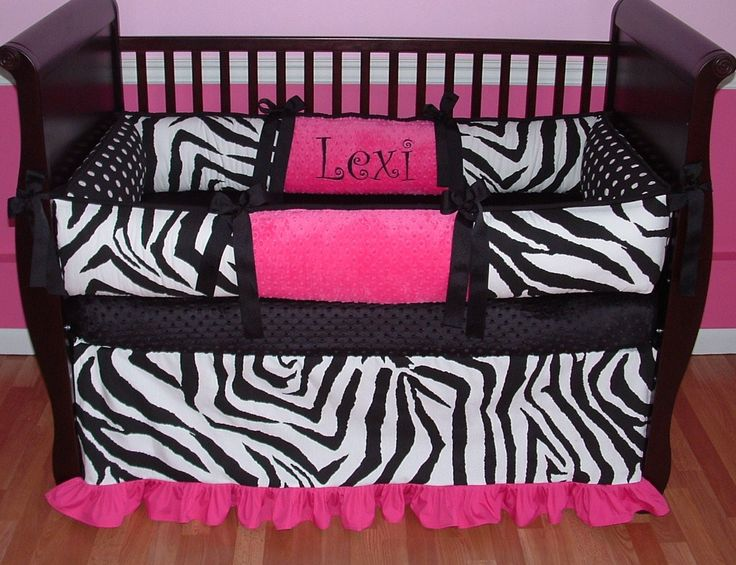 Lexi Zebra Baby Bedding  Included in this set is the bumper, blanket, and crib skirt.  There is lots of detail in this custom set including soft Fuchsia minky, Black grosgrain ties, black and white zebra and polka dots and fuchsia detail trim too.