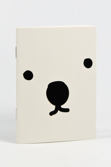 notebook with a little cartoon bear (?) face!