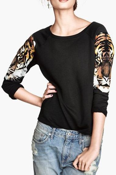 black shirt w/two tigers on the arms, like this but the loose pants no lol I'd put it with a straight leg.