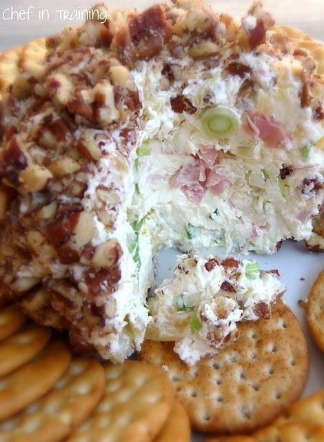 Pineapple Cheese Ball: 1-1/2 packages (12 oz) cream cheese 1 small can crushed pineapple (well drained) powdered sugar (to taste- approximately 2-3 Tbsp.) green onion (optional-to taste, approximately 2 Tbsp.) chopped ham (optional-to taste, approximately 2-3 Tbsp. I used deli meat ham) chopped pecans (about 1 cup worth) Combine all ingredients together. Mash into a ball and chill. Roll in crushed pecans. Refrigerate until served. Serve with crackers.