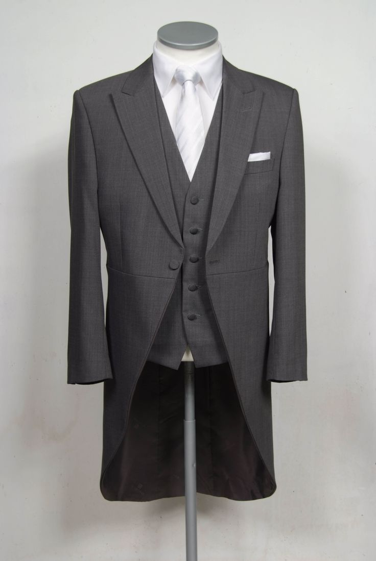 "grooms wedding tails suit grey slim fit in light weight wool with single breasted waistcoat. Mens sizes from 32"" chest upward and include extra short, short, regular, long and extra long fittings. Boys sizes from 20"" to 34"" chest. Complete outfit includes jacket, skinny trousers, hire or matching waistcoat, brand new traditional or French wing slim fit shirt in white or ivory, tie or cravat, braces and cufflinks. £195.00 to hire #groom #wedding #suit #hire #suithire #waistcoat #grey #groom"