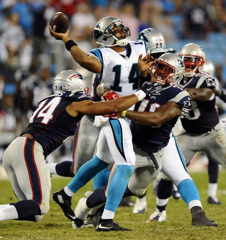 Carolina Panthers' Joe Webb (14) passes the ball before being hit by New England Patriots' Trey Flowers (74) and Rufus Johnson (70) during the second half in their preseason game at Bank of America Stadium on Friday, August 28, 2015. New England won, 17-16.