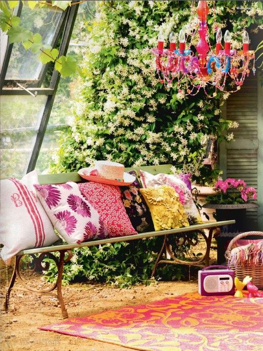 Chill Out Garden Comfy Cushions Have Been Added To A Bench The Eclectic Look Is Completed With Rug Radio And Colourful Chandelier
