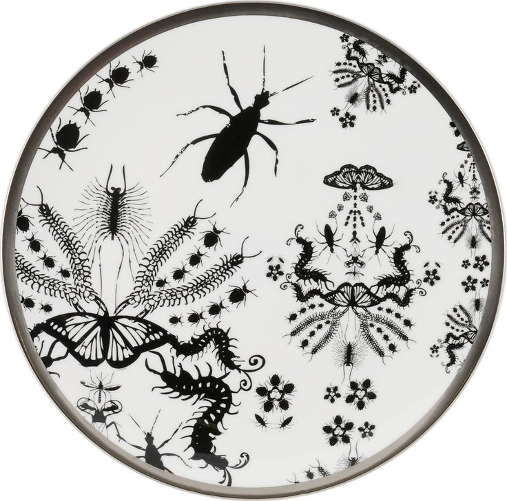 """8"""" 'Entomo' Black Cake Plate – a delicate plate displaying the 'Entomo design in its full glory. Entomo presents an array of some of the most important yet often misunderstood creatures on our planet. From gossamer wings of the butterfly to the architectural magnificence of the stag beetle, together a pattern of wonderment and delight. Designed by Monica Tsang. Handwash Only. Hand gilded platinum rim. Available in Black and Platinum. Made in Stoke-on-Trent, England. Fine Bone China. Find out…"""