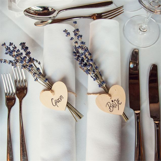 On the top table, the place names were displayed on wooden hearts which were tied to bunches of lavender. There was also homemade 'bride