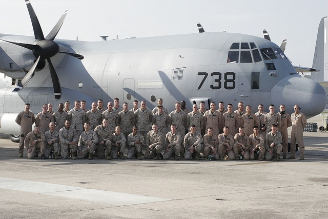 Marines with Marine Aerial Refueler Squadron 252 in front of one of the squadrons C-130's April 2, aboard Marine Corps Air Station Cherry Point, N.C., minutes before taking off to attach to the 24th Marine Expeditionary Unit.