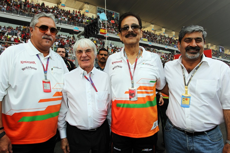 (L to R): Dr. Vijay Mallya, Sahara Force India F1 Team Owner on the grid with Bernie Ecclestone, CEO Formula One Group (FOM), Saharasri - Subrata Roy Sahara, Sahara Chairman and co-owner of Sahara Force India F1 Team and Vicky Chandhok on Race Day of the 2012 Formula 1 Airtel Indian Grand Prix