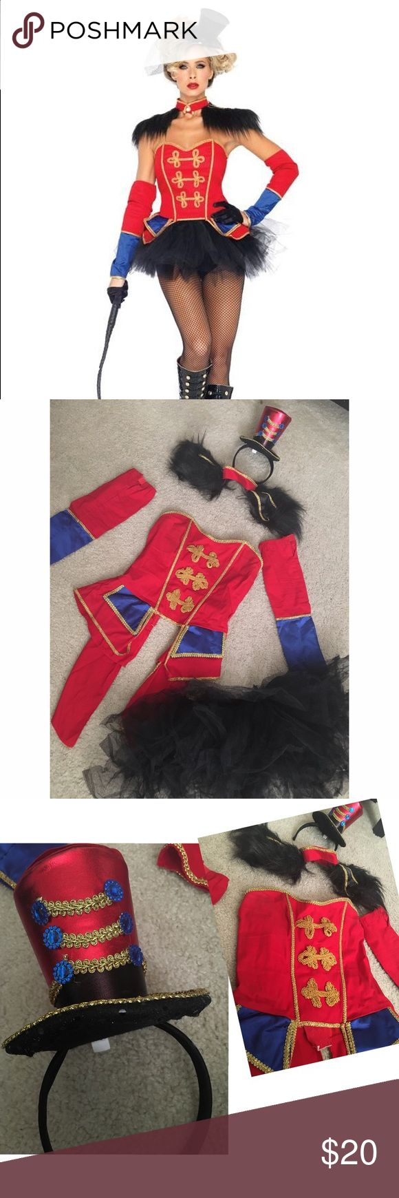 CIRCUS RINGLEADER COSTUME Super cute circus ringleader costume! Comes with: •Corset •Sleeves •Shoulder accessory •Hat •Tulle bottom Corset is very adjustable and can fit up xs-med Worn once for Halloween Leg Avenue Other