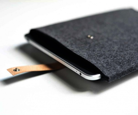":: PRODUCTS :: Available through Cargoh. Lovely & simple design. iPad Sleeve Graphite Wool Felt with Black Leather. Price $48.00 USD. Modern and simple sleeve is made of 1/8"" thick felted wool offering great protection for your reader. Snug fit and simple closure with a hand-dyed leather strap that is riveted on the back and snaps in the front. Snap and rivet locations are lined to keep your iPad from touching anything but soft, thick wool felt. Original design by Byrd & Belle. #products…"