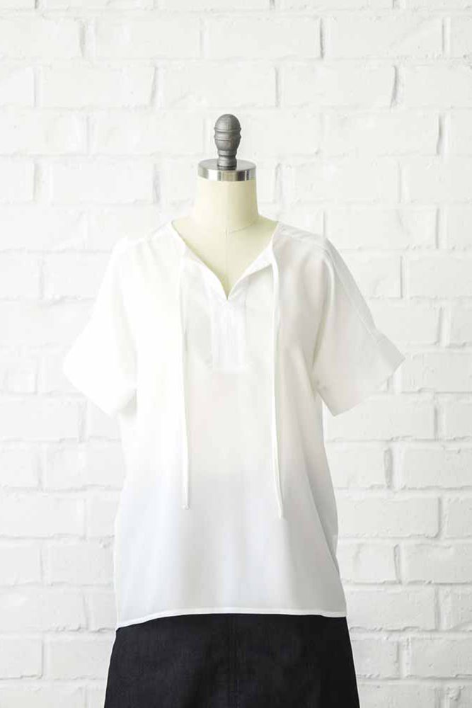 """a795bd995e6e8 Our easy to wear tie neck top comes in white. This modest comfy top  features short sleeves.97% Polyester3% SpandexLength  26.3"""""""