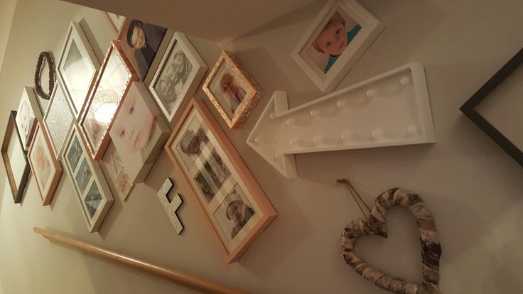 Gallery wall stairs pink copper grey