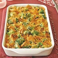 Cheesy Goodness Brocolli Casserole :16 oz Velveeta  1 tsp garlic powder  2 cans cream of Mushroom soup   2 bags Broccoli Floretes [ 24 oz, each] Thawed  2 TB butter  1 large onion  2 sleeves of ritz crackers  4 TB butter for cracker topping