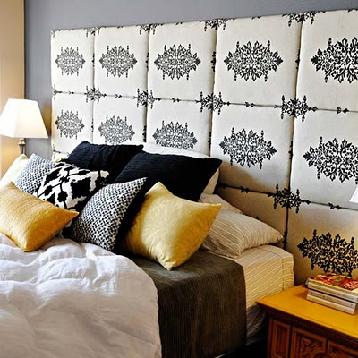 head board - covered squares attached to the wall with Velcro.  Cheap and easy