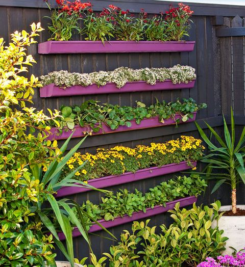 How to build a vertical gutter garden -- No matter how basic your DIY ability, it's easy to create a great feature wall. Here, we've planted up cost-saving PVC gutters and arranged them in tiers, on a painted fence, with brilliant results.