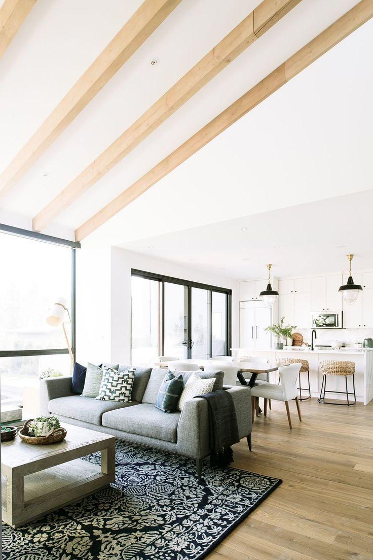 Living room ideas, white walls, gray sofa, black pendants,