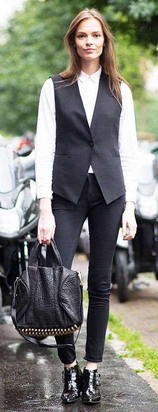 Sleek vest + patent boots = a killer combination