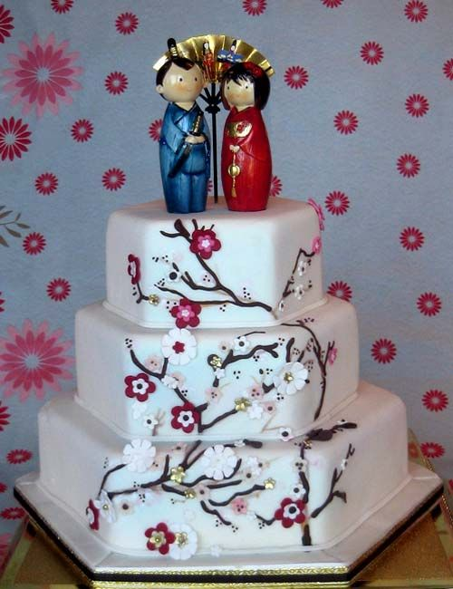 Hexagon shaped, Japanese wedding cake decorated with cherry blossoms and a Japanese bride and groom wedding cake topper Keywords: #weddings #jevelweddingplanning Follow Us: www.jevelweddingplanning.com  www.facebook.com/jevelweddingplanning/