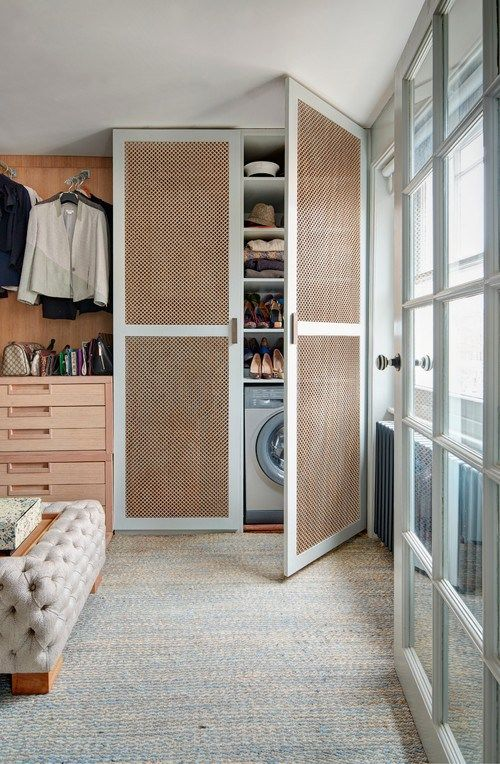 Laundry in bedroom, (backed up to bath?) storage above, folding on bed, efficient, clothes hung outward, not horizontal replace closet.
