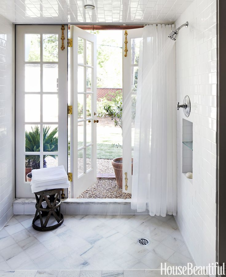 Step directly from the shower to the backyard in architect Bill Ingram's Birmingham, Alabama master bath, which opens onto a pea gravel-bordered lawn.  See the full house tour here. >>   - HouseBeautiful.com
