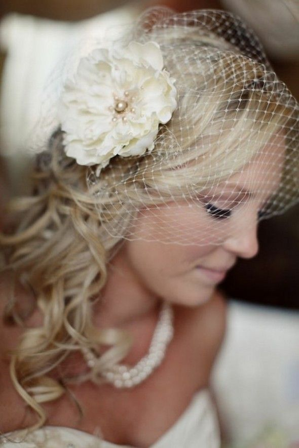 Bridal look with a hair flower & ivory Russian veiling.