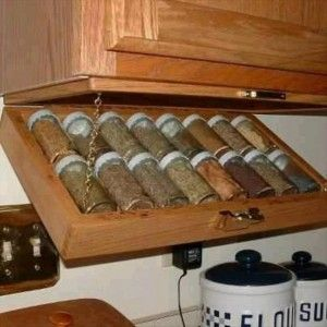 a spice rack, smart idea. what else could I use this idea for?  Cookbook holder possibly?