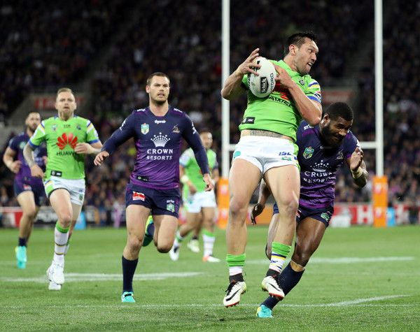 Jordan Rapana of the Raiders is challenged by Marika Koroibete of the Storm during the NRL Preliminary Final match between the Melbourne Storm and the Canberra Raiders at AAMI Park on September 24, 2016 in Melbourne, Australia.