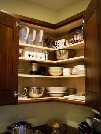 Upper corner cabinet done right...way better than either  a lazy susan or an angled cabinet.