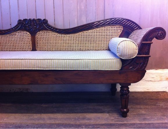 Decorative vintage anglo indian carved rattan scroll armed chaise sofa or settle with new seat & bolster cushions upholstered in striped ticking material.