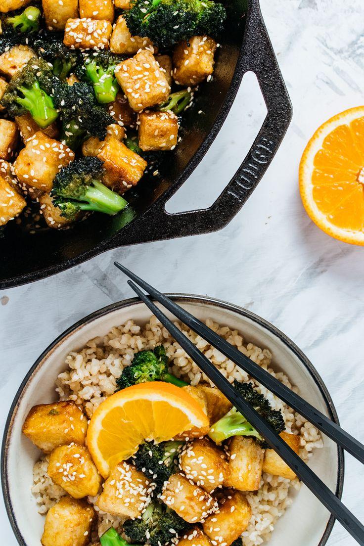 Crispy orange sesame tofu and broccoli. Pan fried tofu with the crispiest exterior that's drenched in an orange sesame sauce with broccoli.