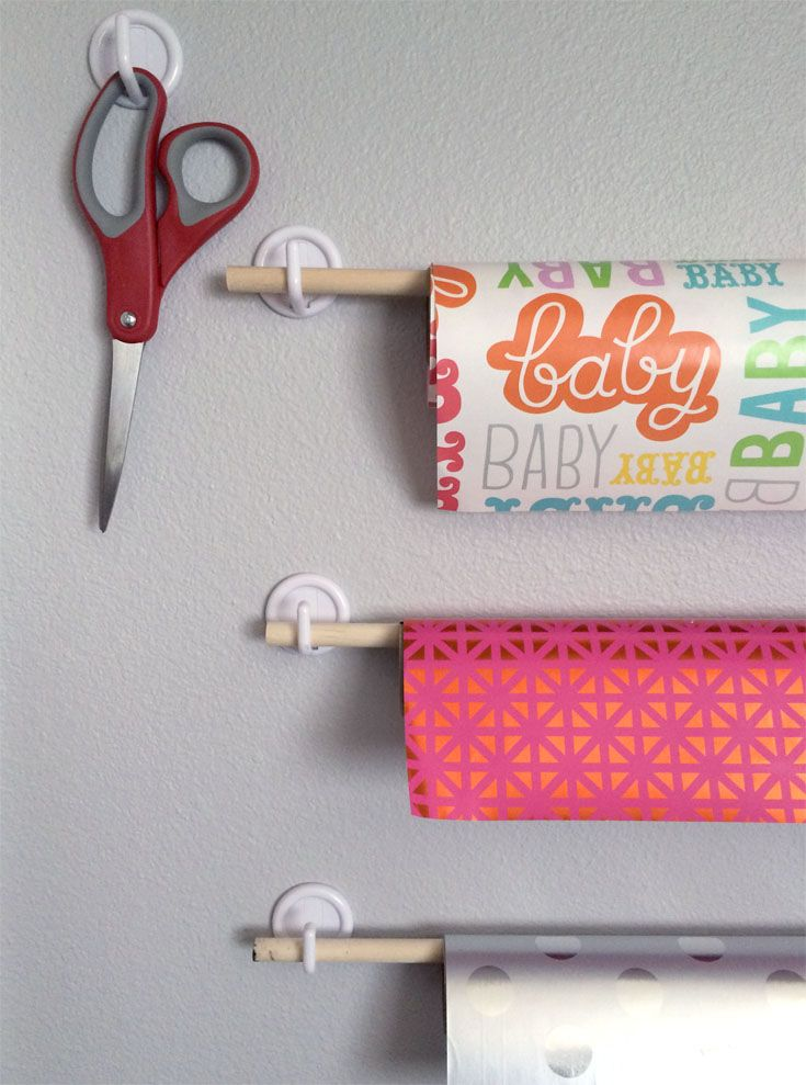 Dowels on hooks for a fast and easy ribbon or wrapping paper dispenser.