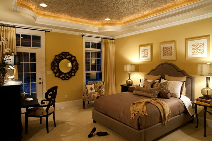 Master Bedroom Including A Tray Ceiling With Lighting Crown Molding Decorative Wallpaper On