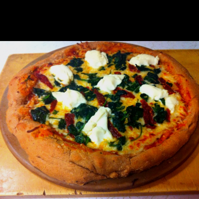 Homemade pizza = Yummy!!Whole wheat crust topped with mozzarella, two ...