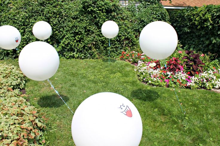 Boo balloons in the grass- this mom did the coolest Super Mario Bros party ever!