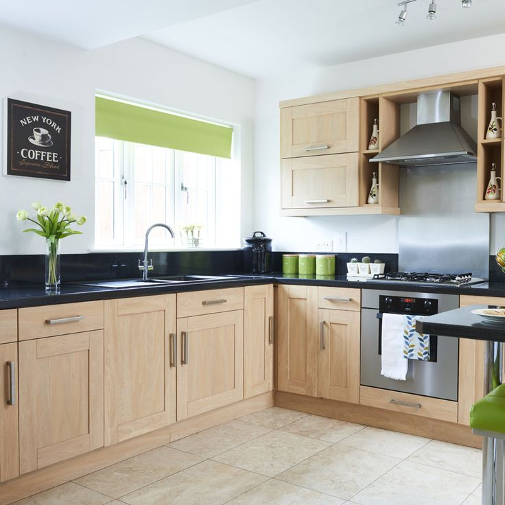 Delightful Neutral Wood Kitchen With Black Worktops And Lime Green Accents