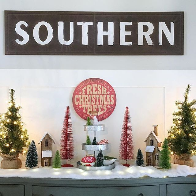 """# @hostessjo We are so enchanted by this adorable holiday vignette. So fun, festive, and creative! Love the illuminating effects of the lights underneath the """"snow"""" and the red trees and Fresh Christmas Tree sign are awesome. Thank you for including our Southern Sign in your most adorable holiday display!⠀ ⠀ #myafh #antiquefarmhouse #farmhouse #farmhousedecor #farmhousestyle #farmhousechic #tablescape #walldecor #southernstyle #southerncharm #holidayvibes #holidayhome #holidaydecor…"""