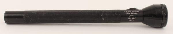 "black KEL-LITE heavy duty flashlight, measuring 19.75 in length was given to Colonel Tom Parker in 1974 by law enforcement agent with the inscription, ""To the Colonel with respect from the chief Jan. '74."" Colonel Parker, Elvis' long time manager, sold this flashlight at one of his impromptu silent office auctions which he held in his office at MGM Studios in Culver city, California. Comes with letters of provenance. Very good condition."