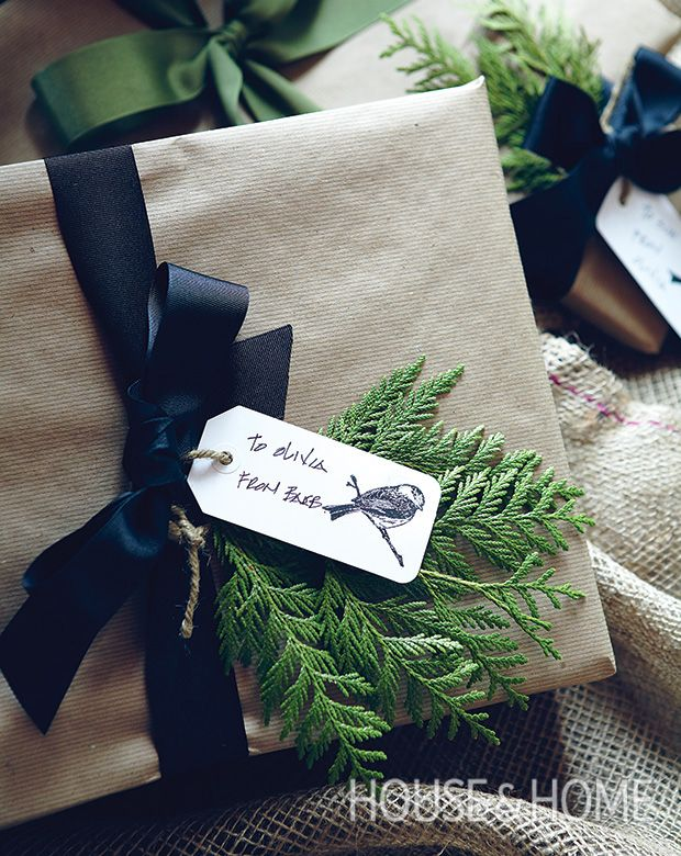 Kraft paper-wrapped gifts with simple black ribbon and fresh greenery cast the perfect au-naturel holiday note. | Photographer: Michael Graydon | Designer: Barbara Purdy