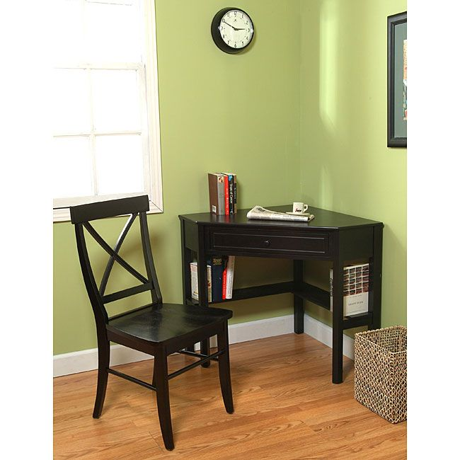 Maximize your home office space with this compact and elegant study set. The two-piece set includes a black corner desk and a matching crossback chair.